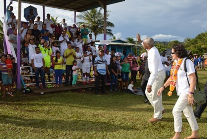 President David Granger greeting members of the Paruima team as he and First Lady Sandra Granger were about to return to Georgetown after the official opening of the Upper Mazaruni 19th Annual District Games at Kamarang, Cuyuni Mazaruni.