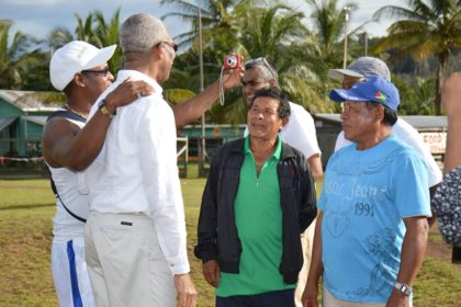 These gentlemen seized the opportunity to pose for 'selfies' with the President as he prepared to leave Kamarang.