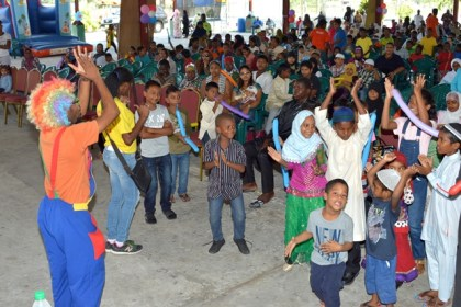 These children were happy to participate in an exuberant song and dance segment of Fun Day, while others looked on.