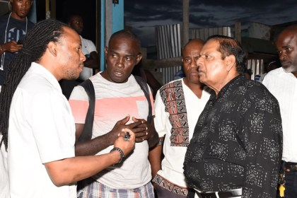 Prime Minister Moses Nagamootoo, and Regional Members of Parliament, Jermaine Figueira and Audwin Rutherford in discussion with a resident during the walkabout