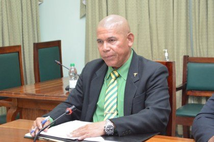 Minister of Public Health, Dr. George Norton issuing a press statement to members of the media, today, at Parliament Building.