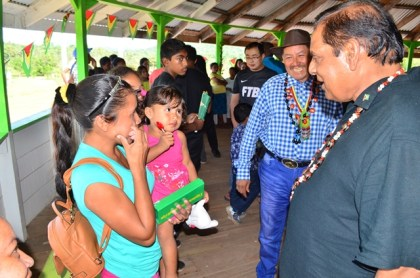 Prime Minister Moses Nagamootoo and Minister of Indigenous Peoples' Affairs Sydney Allicock interacts with Surama residents