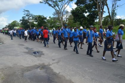 A section of the youths marching along Homestretch Avenue on International Youth Day