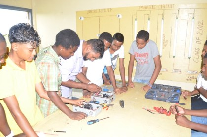 Some of the participants of the skills training programme engaging in practical works