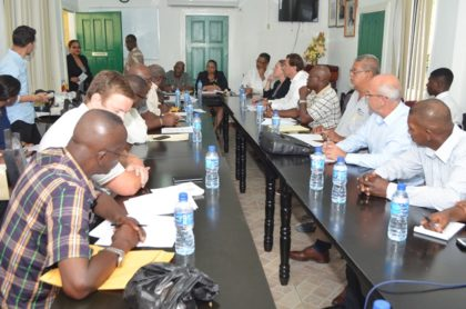 Minister of Social Protection, Volda Lawrence and Minister within the Ministry, Keith Scott engaging officials from the Bauxite Company of Guyana Incorporated (BCGI)