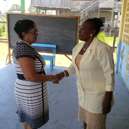 Mrs. Sita Nagamootoo is greeted upon her arrival at the institution