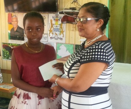Female top performer presented with prize from Mrs. Sita Nagamootoo