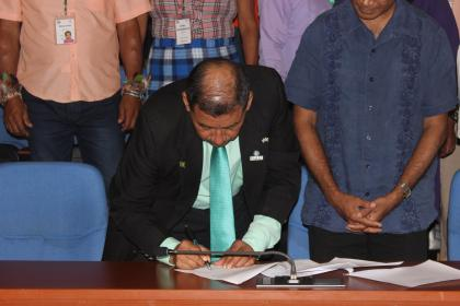 Vice-President and Minister of Indigenous People's Affairs, Sydney Allicock signing as a witness on  the  Memorandum of Understanding between the National Toshaos' Council (NTC) and Conservation International Foundation Guyana Inc (CI-Guyana) on Friday