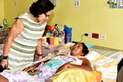 First Lady, Mrs. Sandra Granger comforts Ms. Ophelia James during a visit with her, this morning, at the Georgetown Public Hospital Corporation.