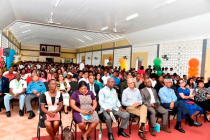 A section of the gathering at today's centenary celebrations of the Berbice High School.