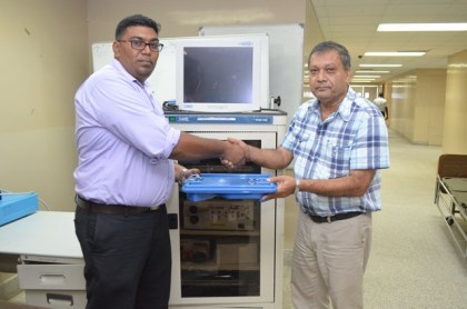 Surgeon and Senior Surgical Registrar, Dr. Ravi Motilall hands over endoscopic equipment to Chief Executive Officer (CEO) of the Georgetown Public Hospital Corporation, Michael Khan