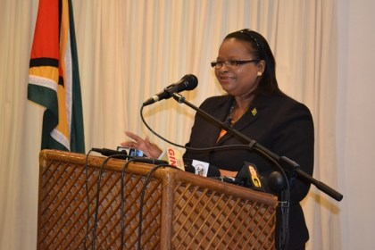 Minister of Social Protection, Ms. Volda Lawrence delivering her address to the at the Reporting handing over ceremony.