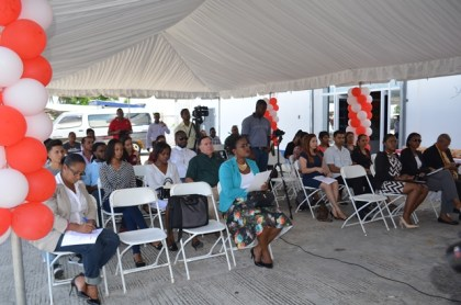 Those gathering at the opening ceremony of the branch of Da Silva's optical, Parika