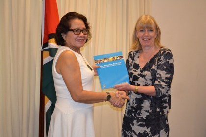 First Lady, Mrs. Sandra Granger receiving her copy of the Situation Analysis Report of Women and Children from UNICEF Representative to Guyana and Suriname, Ms. Marianne Flach.