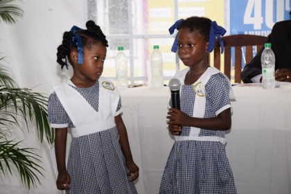 Two pupils of the East Ruimveldt Nursery School performing a poem at the 40th anniversary of the launch of the Guyana Nursery Education Programme at the Roxanne Burnham Nursery School