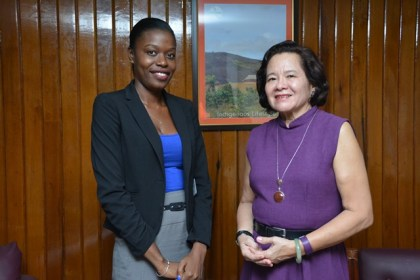 First Lady Mrs. Sandra Granger and Ms. Ms. Marcia Charles, who was awarded a scholarship at the London University of Economics and Political Science