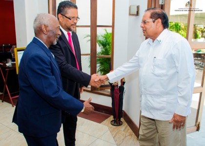 Prime Minister Moses Nagamootoo is being greeted on his arrival at Herdmanston Lodge by Minister in the Ministry of Social Protection, Keith Scott and Chief Labour Officer Charles Ogle