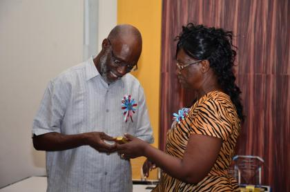 Genevieve Whyte-Need receiving her token of appreciation from Advisor to the Minister of Education, Vincent Alexander.