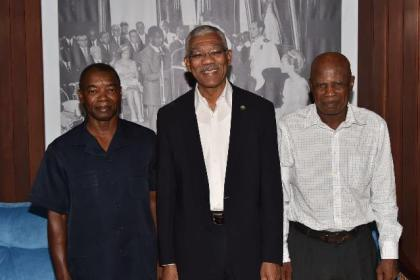 President David Granger is flanked by Dr. Patrick Chesney (left) and Dr. Patrick Williams at the Ministry of the Presidency