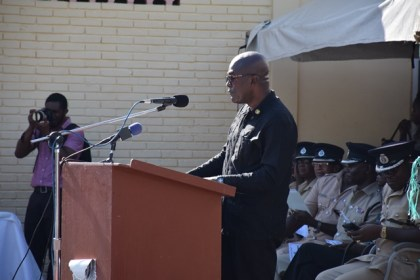 Assistant Police Commissioner and Head of the Presidential Guard, Brian Joseph giving the charge to the recruits