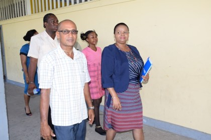 Minister of Social Protection, Volda Lawrence having a walk through at the Skeldon High School led by HM Chandradeo Mahadeo