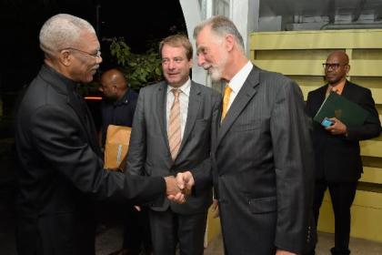 President David Granger being received by Germany's Regional Director for Latin America and the Caribbean, Ambassador Dieter Lamle and Germany's Ambassador to Guyana, Mr. Lutz Hermann Gorgens at the Georgetown Club, where a reception was held to mark 50 years of bilateral relations between Guyana and Germany.