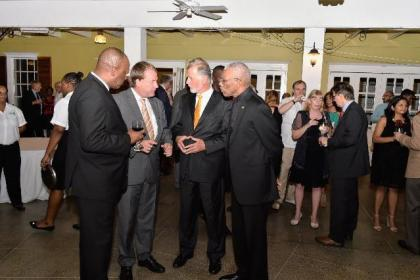 From left- Minister of State, Mr. Joseph Harmon, Germany's Regional Director for Latin America and the Caribbean, Ambassador Dieter Lamle, Germany's Ambassador to Guyana, Mr. Lutz Hermann Gorgens and President David Granger in discussion during the reception.