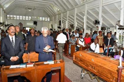 President David Granger and Minister of Legal Affairs, Mr. Basil Williams during the funeral service