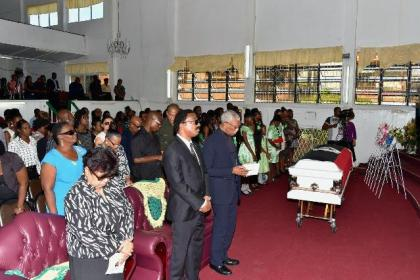 President David Granger, Attorney General and Minister of Legal Affairs, Mr. Basil Williams and Minister of Social Cohesion, Ms. Amna Ally at the funeral service