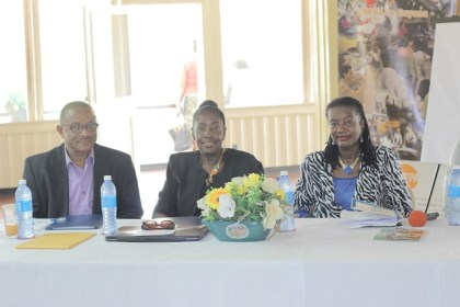 National Director of the NCDC Eugene Gilbert, Minister within the Ministry of Communities, Valerie Adams-Patterson, and United Nations Population Fund Regional Representative, Patrice La Fleur at the opening of the workshop