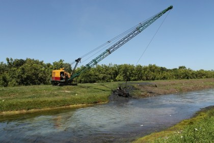 Dragline at work, clearing Canal Number One, West Bank Demerara