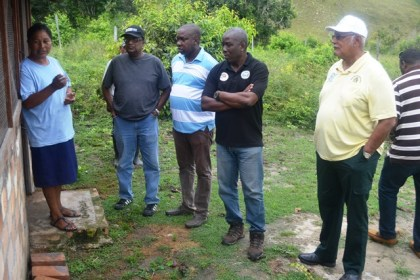 minister-holder-ps-george-jervis-and-narei-ceo-dr-homenauth-in-discussion-with-the-chairperson-of-teh-ruperty-womens-group-during-an-outreach-to-region-9
