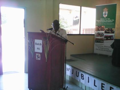 Mr. Winston Felix, Minister of Citizenship delivering the Charge to the participant.