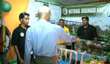 Minister of Communities Ronald Bulkan checks out the National Drainage and Irrigation Authority (NDIA) booth at Essequibo Night 2016