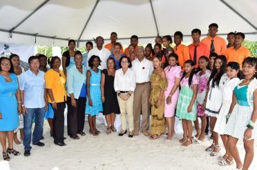 President David Granger and First Lady, Mrs. Sandra Granger (centre) and Mrs. Supriya Singh-Bodden with the participants, who successfully completed the various courses over the last few months