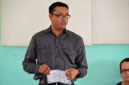 Mr. Yohann Sanjay Pooran, facilitator at Interweave Solutions Incorporated addressing the women at the opening of the Self-Reliance and Success in Business workshop at Kuru Kururu.