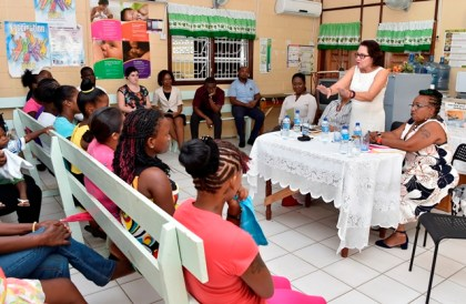 First Lady, Mrs. Sandra Granger gestures as she makes a point during her presentation at the launch of the Teenage Pregnancy Support Group at the Sophia Health Centre yesterday. She is flanked at the head table by, from left to right, Dr. Onika Scott, Ms. Desiree Edghill and Dr. Dawn Stewart.