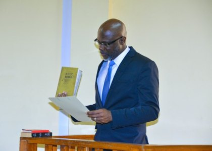 Presidential Advisor on the Environment, Rear Admiral (ret'd) Gary Best takes the oath, today, in  Court One of the Georgetown Magistrate's Court.