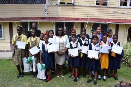 Minister within the Ministry of Public Health, Dr. Karen Cummings with the students who participated in the poster competition