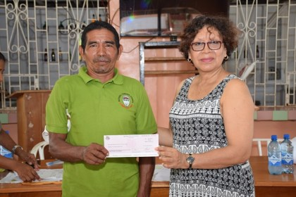 Toshao of Versina community receiving Jubilee grant from Minister within the Ministry of Indigenous Peoples' Affairs Valerie Garrido-Lowe