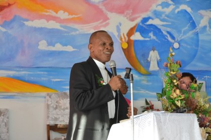 Rev. Andrew Morris-Grant of the Franklin Talbot Memorial African Methodist Episcopal Church representative to Guyana and Suriname leading the congregation in worship