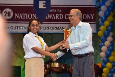 Minister of Education Dr. Rupert Roopnarine one of the Best 2016 CAPE performer Ashley John