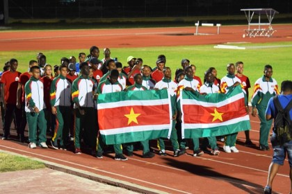Athletes representing Suriname during their March pass