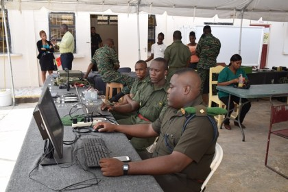 Members of the Guyana Defense Force are geared up as they await patrons to visit their booth