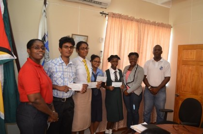 Essay competition winners with Chief Port Security Officer Dwain Nurse (White Shirt) and Director of Ports, Louise Williams (Red Shirt).