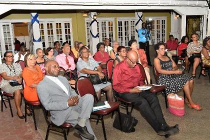 Prime Minister (acting) and Minister of Foreign Affairs, Mr. Carl Greenidge seated in the audience at the launch