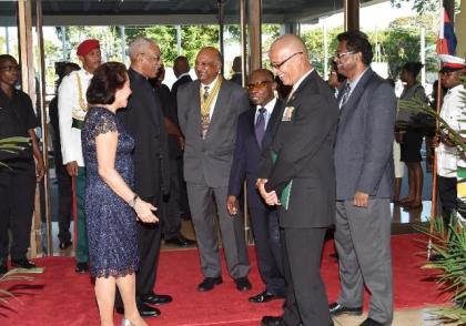 President David Granger shares a light moment with Chancellor of the Judiciary, Justice Carl Singh, upon his arrival at the National Cultural Centre while First Lady, Mrs. Sandra Granger and acting Prime Minister and Minister of Foreign Affairs, Hon. Carl Greenidge, look on.