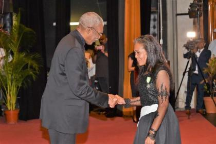 Senior Confidential Secretary to the President in the Ministry of the Presidency, Ms. Nancy Ferreira receives her Medal of Service from President David Granger