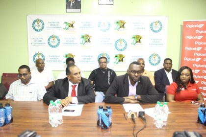 Director of Sports Christopher Jones (front row, second from right), Chairman of the National Sports Commission Ivan Persaud (second from left, front row) with representatives from various sponsors and sports discipline