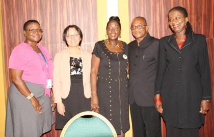 Minister within the Ministry of Communities, Valerie Adams-Patterson,  United Nations Population Fund Regional Representative, Patrice La Fleur and National Director of the NCDC Eugene Gilbert, at the closing of the workshop at Pegasus, Georgetown.
